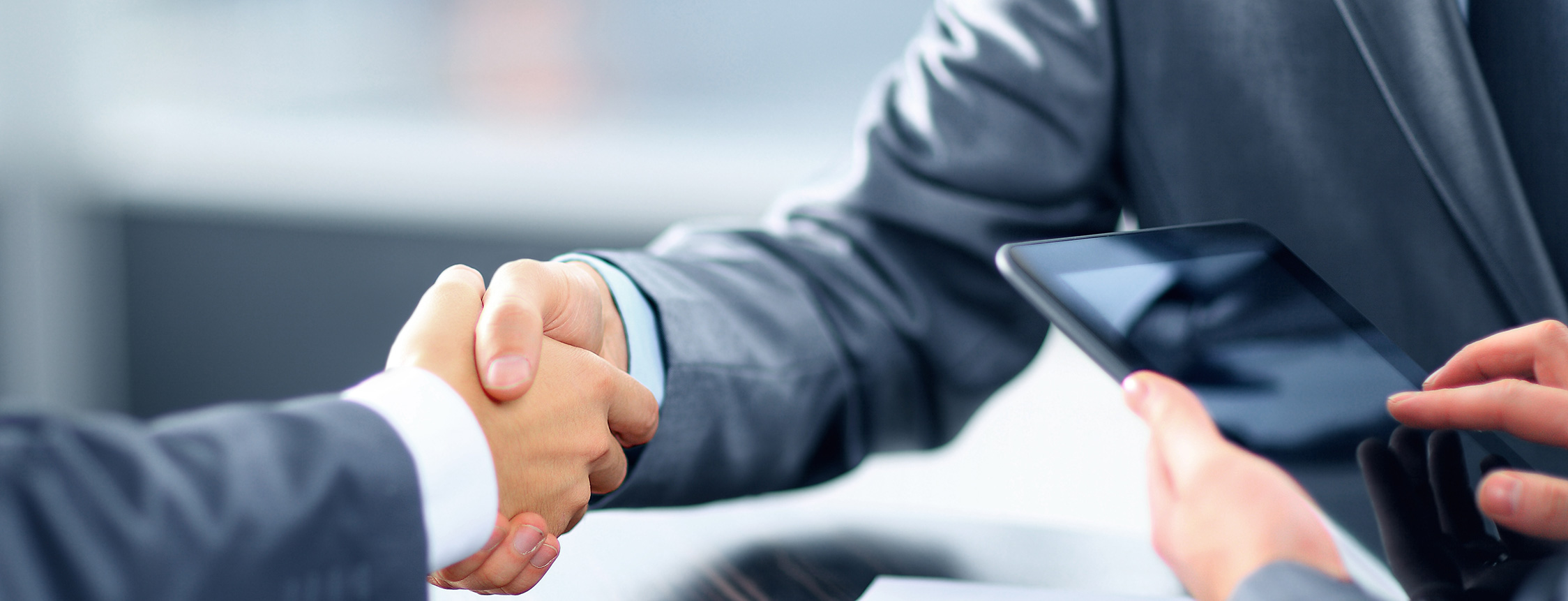 bigstock-Business-handshake-crop2